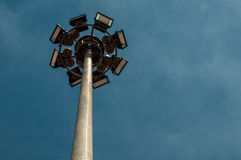 Spotlight tower. With blue sky background royalty free stock photo