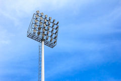 Spotlight tower at sport arena stadium Stock Photos