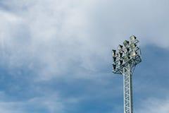 Spotlight. Under blue sky in the football stadium Stock Photos