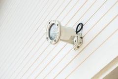 Spotlight on the wall Stock Photo