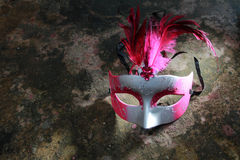 A spotlighted carnival mask Stock Photo