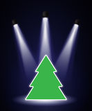 Spotlighted Christmas tree. A Christmas tree shape in the spotlight with space for your text vector illustration