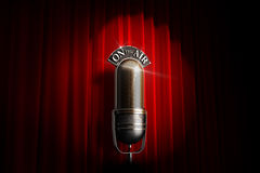 Spotlighted vintage microphone Royalty Free Stock Images