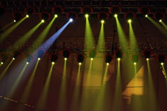 Spotlightings shining over stage. Stage spotlights shooting down towards a stage Royalty Free Stock Image