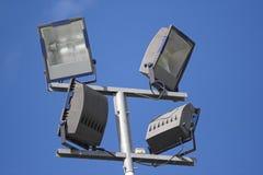 Spotlights. Four spotlights by the sport place Stock Photo
