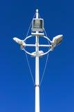Spotlights against blue sky Stock Photos