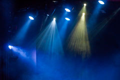 Spotlights in Blue Fog. Theatrical spotlights shining through fog on a stage stock photos