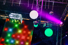 Spotlights in a concert. Flashing stage lights and video beam in a concert Royalty Free Stock Image