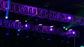 Spotlights at the disco. Constructions of the stage at the concert. Beautiful and colorful lights of the stage at the