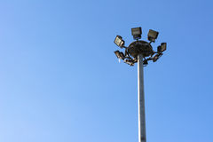 Spotlights electric poles with blue sky for background royalty free stock photo