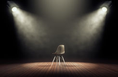 Spotlights illuminate empty stage with chair in dark background. 3d rendering Stock Photography