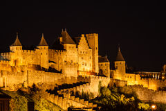 Spotlights illuminate medieval walls and towers Stock Image