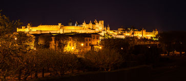 Spotlights illuminate medieval walls and towers Stock Images