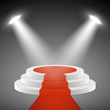 Spotlights illuminate stage pedestal with red carpet. Award ceremony vectror concept background Royalty Free Stock Photos