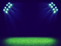Spotlights illuminating area of grass court Stock Photos
