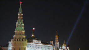 Spotlights over Moscow Kremlin and St. Basil's Cathedral. Night view. stock footage