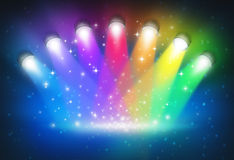 Spotlights With Rainbow Colours. As a magical abstract background of a concert lighting on a dark glowing theater stage with shiny sparkles with a blank center Stock Photos