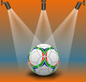 Spotlights and soccer ball Royalty Free Stock Photography
