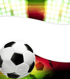 Spotlights and a soccer ball Stock Photos