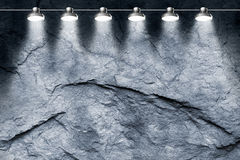 Spotlights on stone wall Stock Image