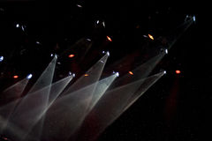 Spotlights in theatre. Colorful spotlights in theatre shining in darkness stock photos