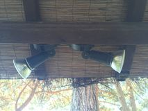 Spotlights under wood beam and bamboo roof Royalty Free Stock Image