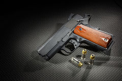 Spotlit handgun Stock Images