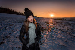 Spotlit portrait of a young girl in winter outfit Stock Photography