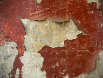 Spots of oil paint on an old wall. Background. Royalty Free Stock Image