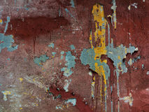 Spots of oil paint on an old wall. Background. Royalty Free Stock Photos