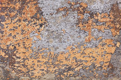 Spots of old yellow paint on a cement wall Royalty Free Stock Photography