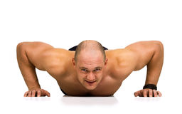 Spotsman doing push-ups Stock Image