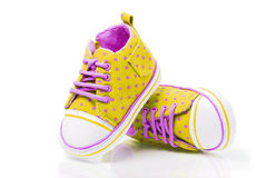 Spotted baby sneakers Stock Photo