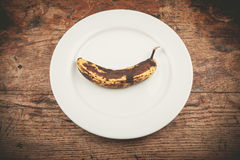 Spotted banana on plate Royalty Free Stock Images