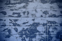 Spotted blue and white wall background Royalty Free Stock Photography
