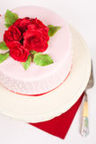 Spotted cake with red roses Stock Photo