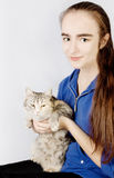 Spotted cat in the hands of a teenage girl Stock Photos