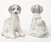 Spotted Dalmatians. Ceramic figurine, dog breed isolated on white stock image