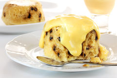 Spotted dick pudding with custard Royalty Free Stock Images