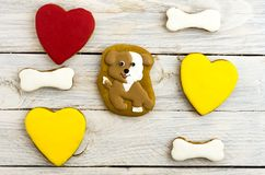 Spotted dog, hearts and bones. Sweet cakes. White background Royalty Free Stock Photo