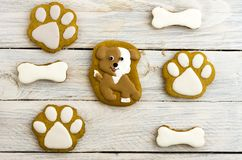 Spotted dog, paw prints and bones. Sweet cakes. White background Stock Images