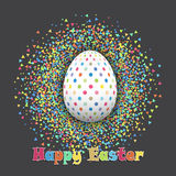 Spotted Easter egg on confetti background Royalty Free Stock Photos