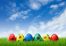 Spotted easter eggs in grass Royalty Free Stock Photo