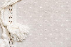 Spotted fabric with a strip of lace and a rope Royalty Free Stock Photography
