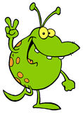 Spotted green alien smiling Stock Photo