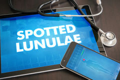 Spotted lunulae (cutaneous disease) diagnosis medical concept on. Tablet screen with stethoscope Stock Image