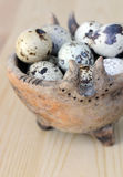 Spotted Eggs. Spotted quail eggs in a small ceramic hand-made bowl stock photo