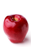 Spotted single ripe juicy red apple. With stem on a white background Royalty Free Stock Photo