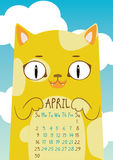 Spotted yellow cat on blue sky background. April calendar. Spotted yellow cat on blue sky background with clouds. April calendar Royalty Free Stock Photo