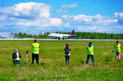 Spotting fans shoot the Brussel Airlines airplane at official traditional spotting for professional and amateur aviation. SAINT PETERSBURG, RUSSIA - MAY 11, 2016 royalty free stock image